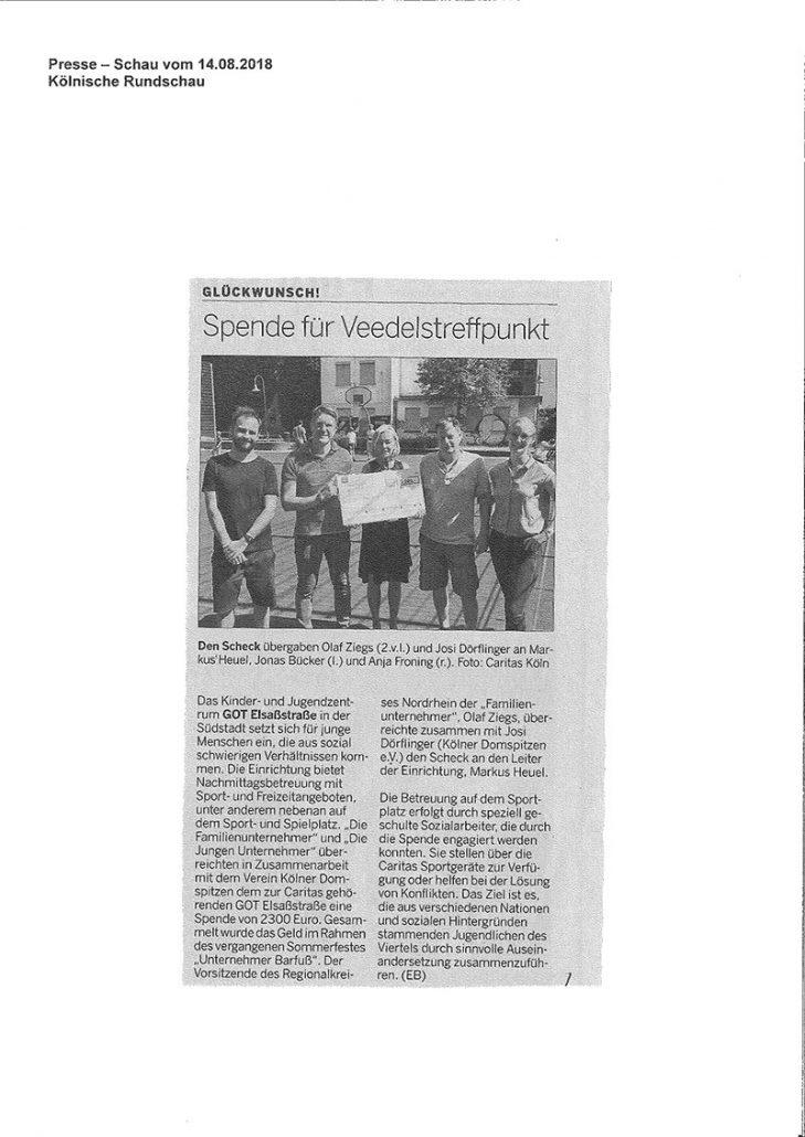"""Zeitungsartikel und Bild in der Kölner Rundschau s. über die Scheckübergabe der """"Familienunternehmer"""" und der """"Jungen Unternehmer"""" mit dem Domspitzen eV an die Caritas. Anlass ist die mobile Jugendarbeit auf dem PEV-Platz in der Kölner Südstadt."""